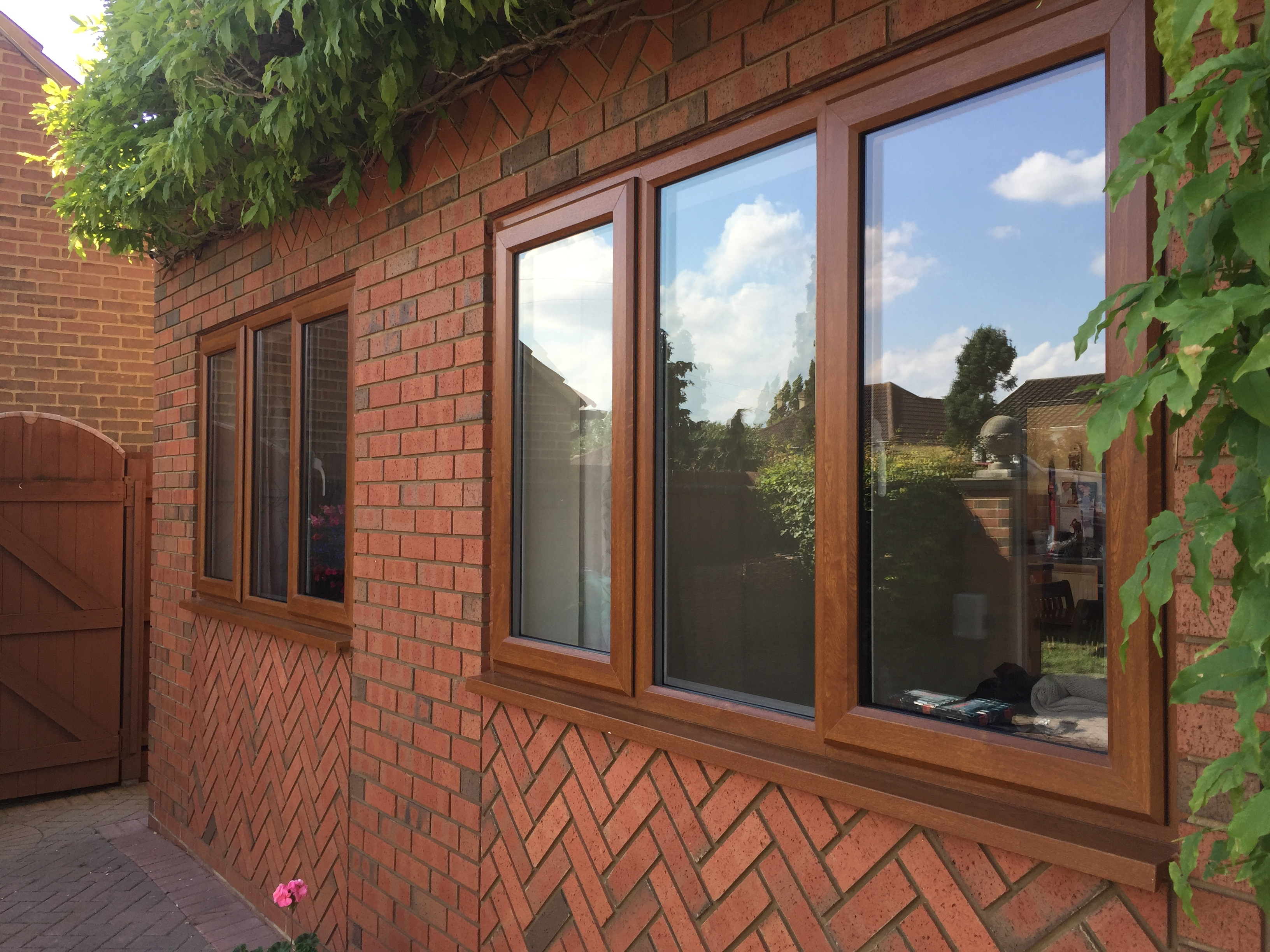 before and after golden oak rehau 70 (2)